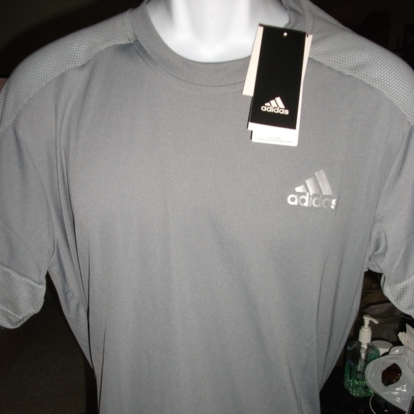 Adidas Polyester T-shirt. Brand new. Mens Size: L